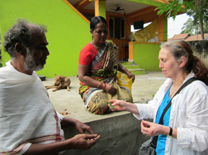 Diana talking to particpants of the Tamwed Mooligai Thottam (herb garden) project